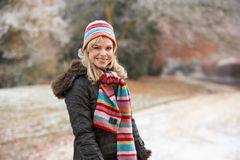 Woman On Winter Walk Through Frosty Landscape. Smiling Royalty Free Stock Image