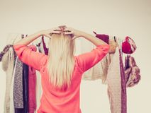 Woman in winter wardrobe deciding what wear Royalty Free Stock Photos
