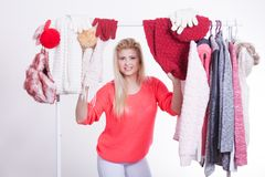 Woman in winter wardrobe deciding what wear Royalty Free Stock Images
