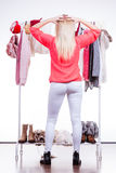 Woman in winter wardrobe deciding what wear Stock Photography