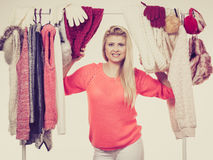 Woman in winter wardrobe deciding what wear Royalty Free Stock Photography