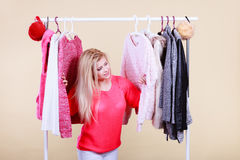 Woman in winter wardrobe deciding what wear Royalty Free Stock Photo