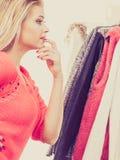 Woman in winter wardrobe deciding what wear Royalty Free Stock Image