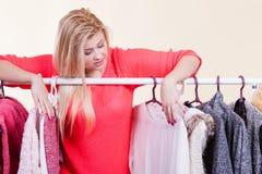 Woman in winter wardrobe deciding what wear Stock Photo