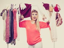 Woman in winter wardrobe deciding what wear Stock Images