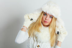 Woman in winter warm clothes fur cap scarf Royalty Free Stock Photos