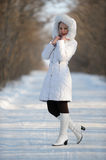 The woman in the winter white clothes Royalty Free Stock Image