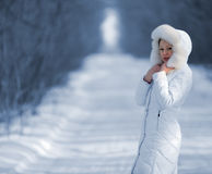 The woman in the winter white clothes Royalty Free Stock Images