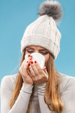 Woman in winter wool cap drinking tea Royalty Free Stock Images