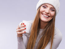 Woman in winter wool cap drinking tea Stock Photography
