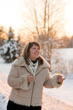 Woman on winters sunset Stock Images