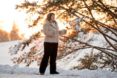 Woman on winters sunset Stock Image