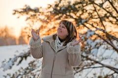 Woman on winters sunset Stock Photos