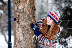 Woman in wintertime Stock Images