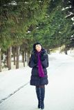 Woman in wintry coat Stock Images