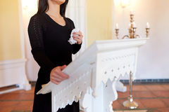 Woman with wipe crying at funeral in church Royalty Free Stock Photos