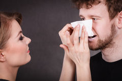 Woman wipe man face by hygienic tissue. Stock Photography