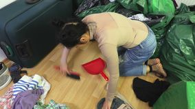 Woman wiped the dirty floor. In room stock video