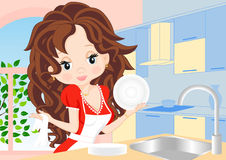 Woman wipes the dishes in the kitchen Stock Image