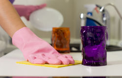 Woman wiping the counter as she washes up Royalty Free Stock Photography