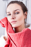 Woman wiping the face Stock Photo