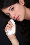 Woman wiping her tears Stock Images
