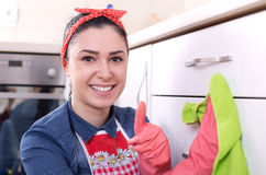 Woman wiping kitchen drawers Royalty Free Stock Photo