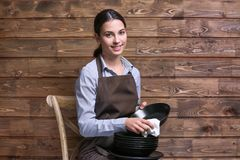 Woman wiping plate with napkin. On wooden background Stock Images