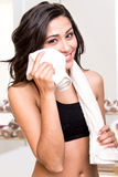 Woman wiping sweat with towel Royalty Free Stock Photos