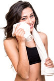 Woman wiping sweat with towel Royalty Free Stock Photography