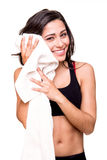 Woman wiping sweat with towel Stock Images