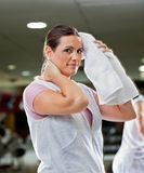 Woman Wiping Sweat With Towel At Health Club Stock Image