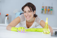 Woman wiping table top. Woman wiping the table top Stock Photos