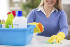 Woman wiping table Royalty Free Stock Photos