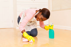 Woman wiping wooden floor Royalty Free Stock Photography