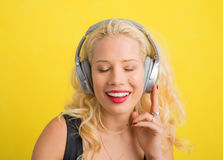 Woman with wireless headphones enjoying music Royalty Free Stock Images