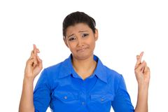 Woman wishing. Closeup portrait of young funny looking woman crossing fingers, wishing, praying for miracle, hoping for the best, isolated on white background Stock Photos