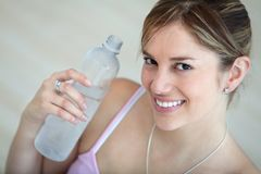 Woman wit a bottle of water Stock Images