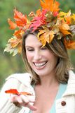 Woman wit Fall leaves and butterfly, seasonal Stock Image