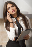 Woman wit tablet and mobile phone Royalty Free Stock Image