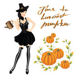 Woman in witch costume for halloween. Harvests pumpkin. Smoky Eye makeup. Woman in striped stockings, corset, black skirt and old cap with belt Royalty Free Stock Image