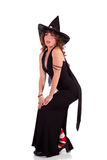 Woman in witch costume striking a sexy pose Stock Photos
