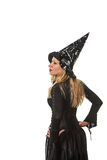 Woman in a witch costume Stock Images