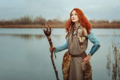 Woman is a witch. Royalty Free Stock Image