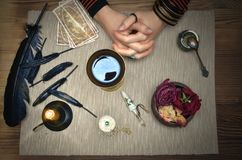 Woman witch prepare a magic potion. Tarot cards. Future reading. Fortune teller concept. Woman witch prepare a magic potion. Future reading. Tarot cards on stock photo