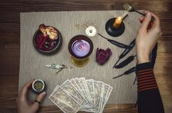 Woman witch prepare a magic potion. Tarot cards. Future reading. Fortune teller concept. Woman witch prepare a magic potion. Future reading. Tarot cards on stock image