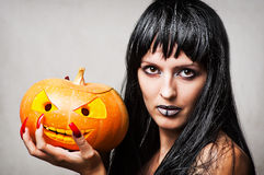 Woman witch with pumpkin Royalty Free Stock Photography