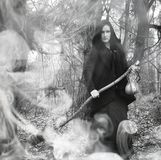 Woman in a witch suit in a dense forest Stock Photography
