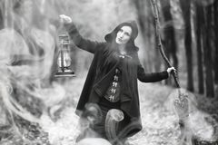 Woman in a witch suit in a dense forest. A woman in a witch suit in a dense forest on a ritual Royalty Free Stock Photo