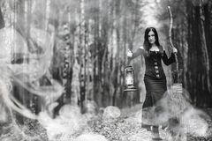 Woman in a witch suit in a dense forest. A woman in a witch suit in a dense forest on a ritual Stock Image